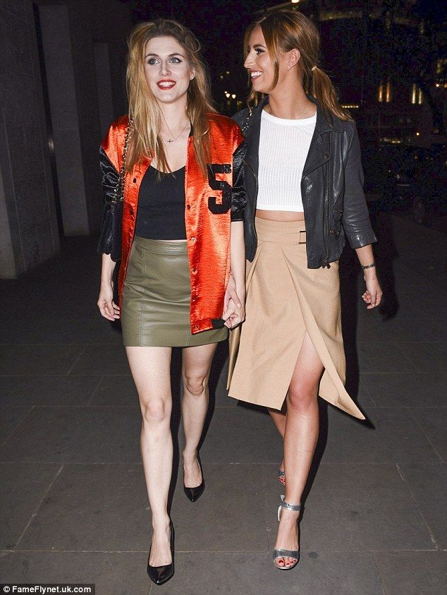 Fashionable foodie: The TOWIE star finished off her look with a beige skirt featuring a da...