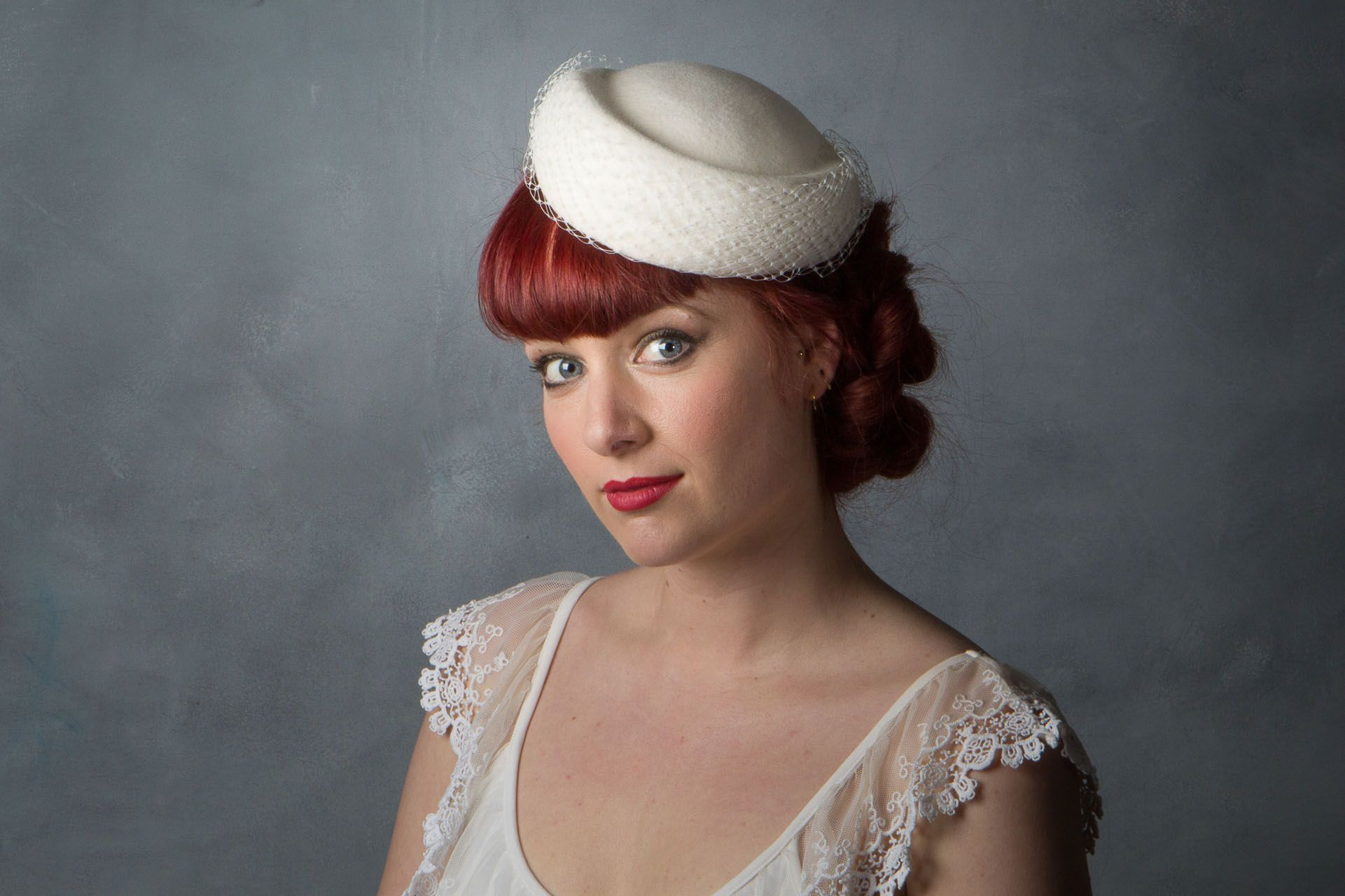 b2718c143f4 1950s Style Bridal Pillbox Hat This hat has several ways of being worn and  is actually