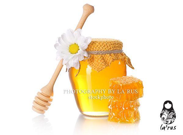 Honey jar with honeycomb slice Buy this photo: http://www.istockphoto.com/stock-photo-22016913-honey-jar-with-honeycomb-slice.php?st=ff01df0