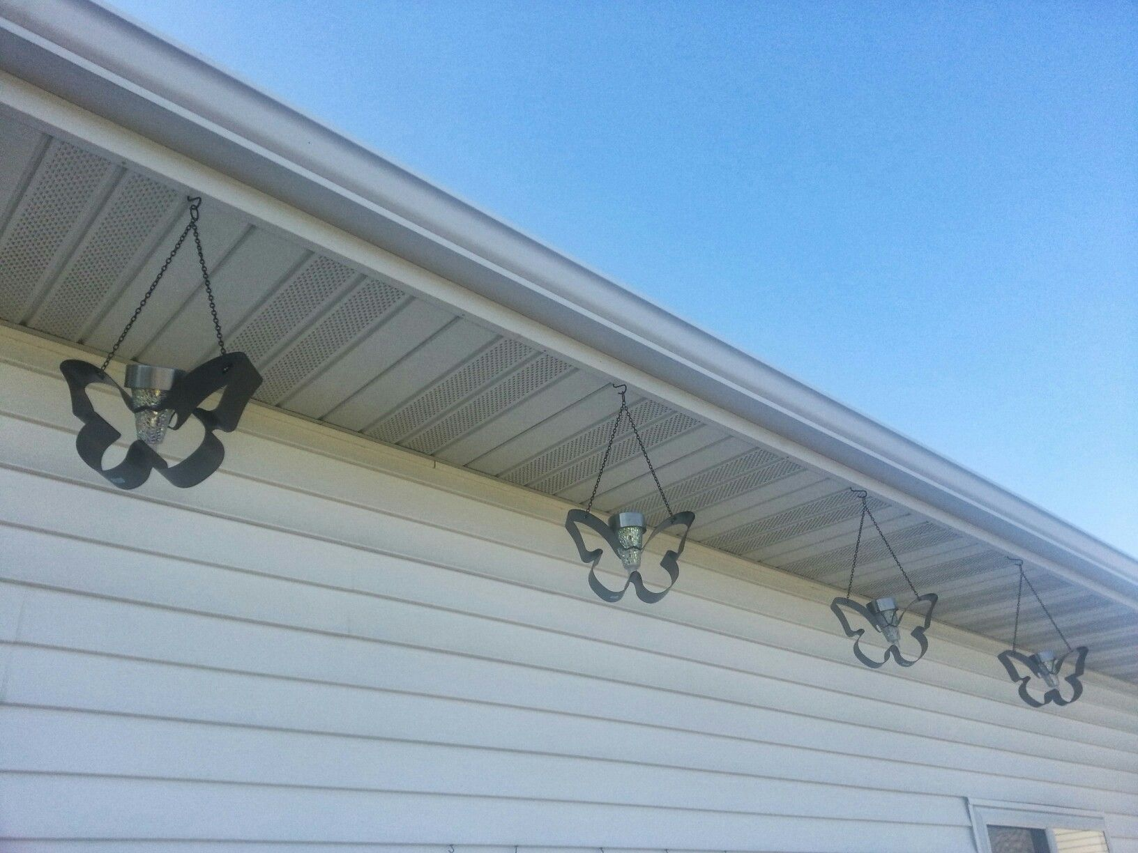 Partylite butterflies hanging from garage mid 2010s
