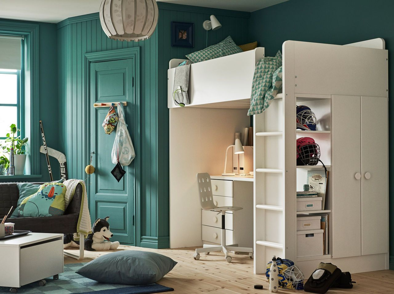Children's bedroom with turquoise walls and white loft bed