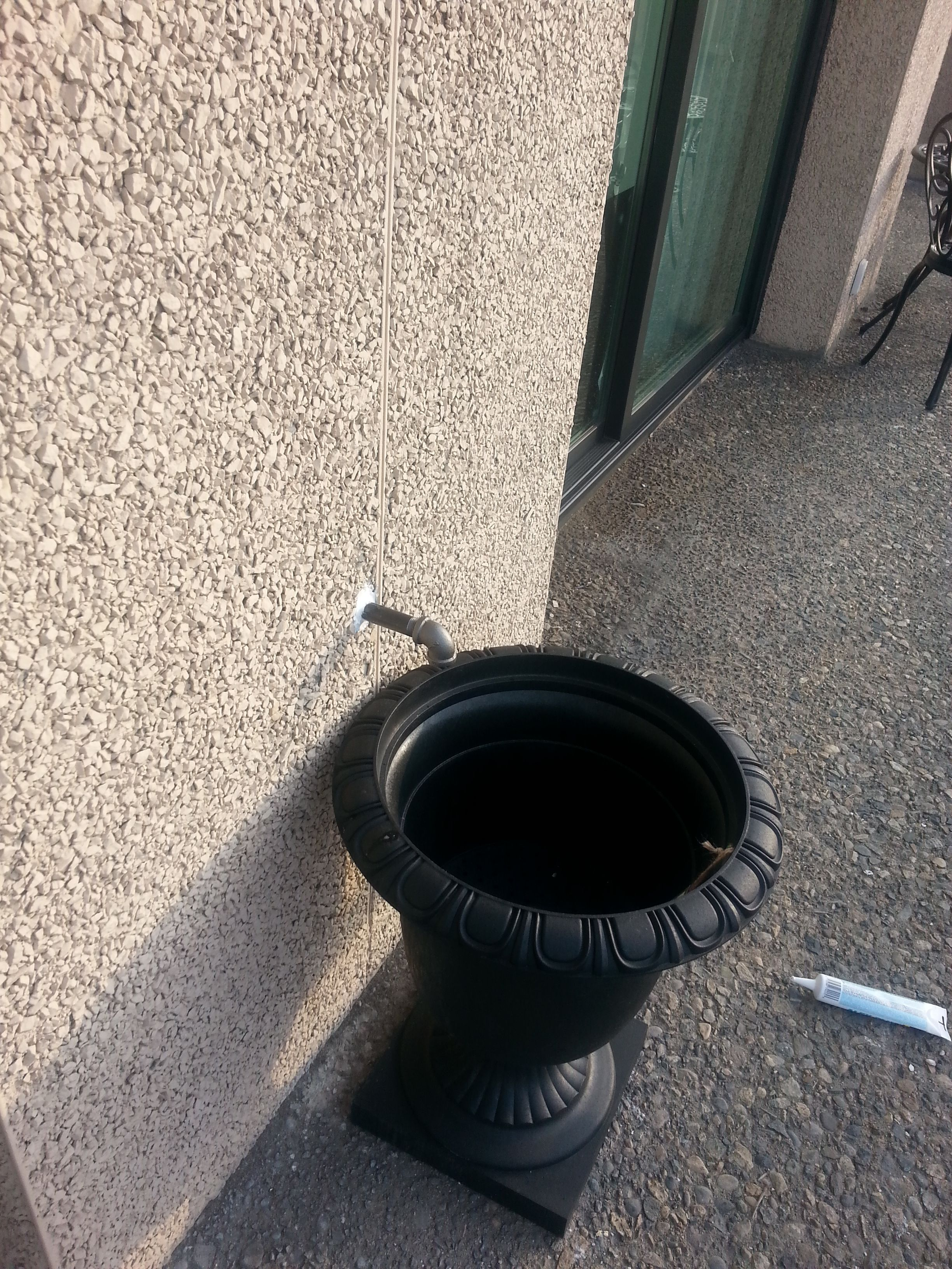 Condensate Drain From The Wall Mounts To A Flower Pot Eliminating