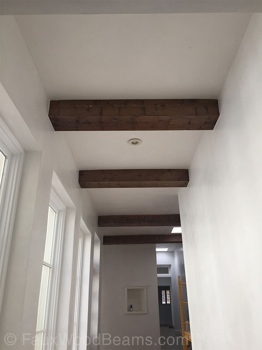The Look Of Natural Wood For Less Faux Ceiling Beams Wood Beam Ceiling Wood Walls Bedroom