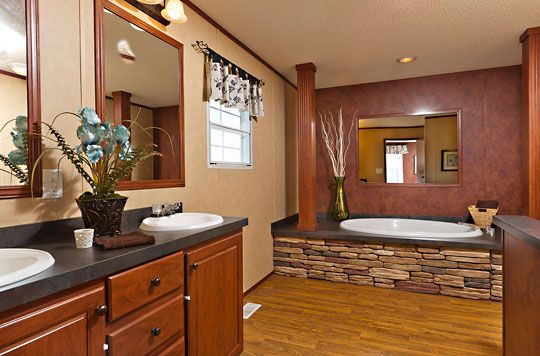 Stone Accents And Columns Make This Bathroom Feel Elegant Www