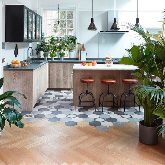 a cool wood and tile transition on a contemporary kitchen ...