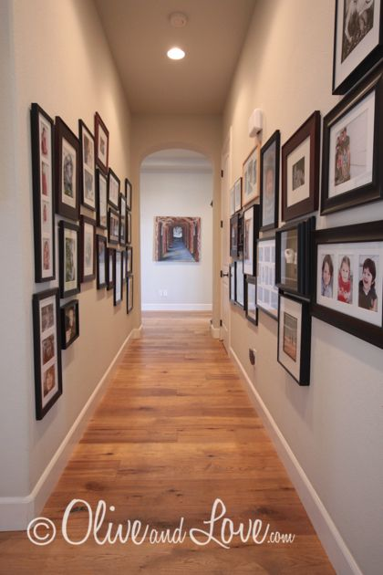 Long Hallway With Family Photo Gallery Family Gallery Wall Photo Gallery Hallway Hallway Decorating