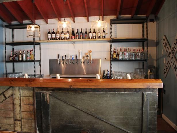 shelving behind bar with a curtain with pipe rod to seperate rooms ...