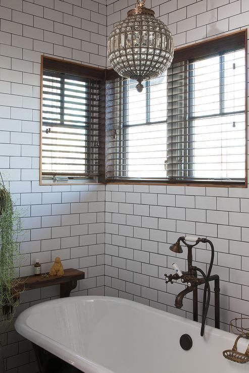 Bathroom Chandeliers Black beautiful bathroom features walls clad in white subway tiles