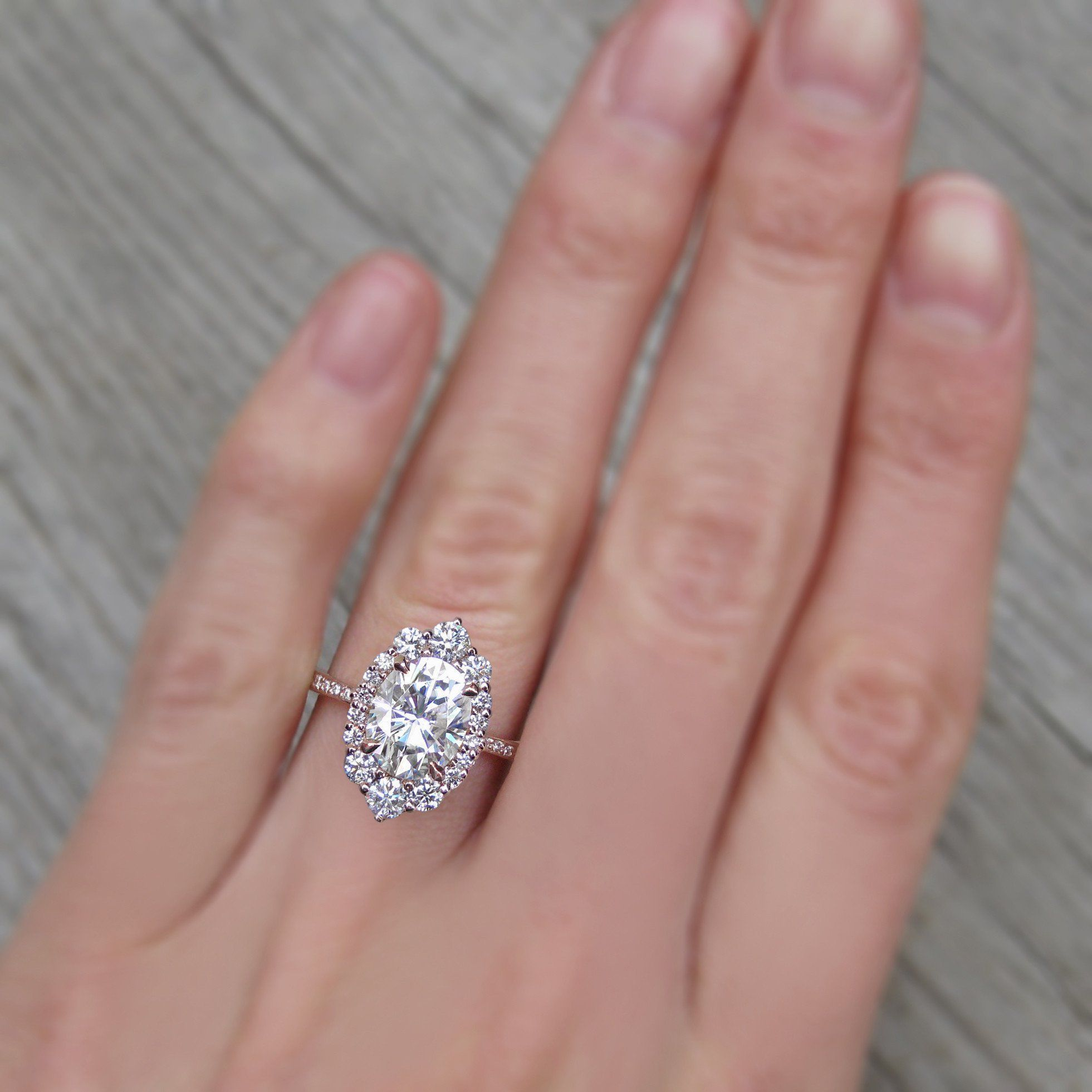 Rose gold Forever One moissanite halo engagement ring with conflict ...