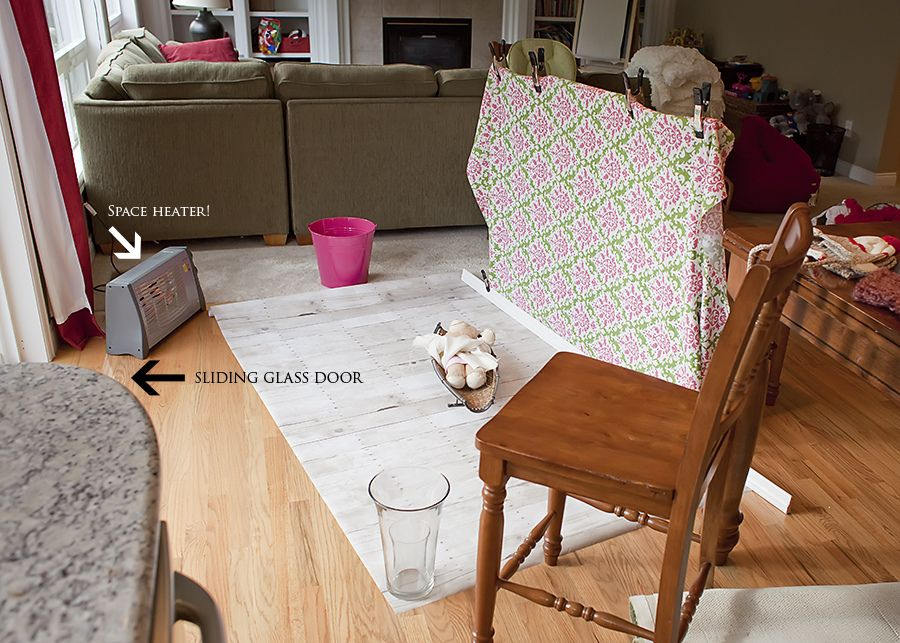 Diy newborn baby studio pin fabric to top of the two chairs