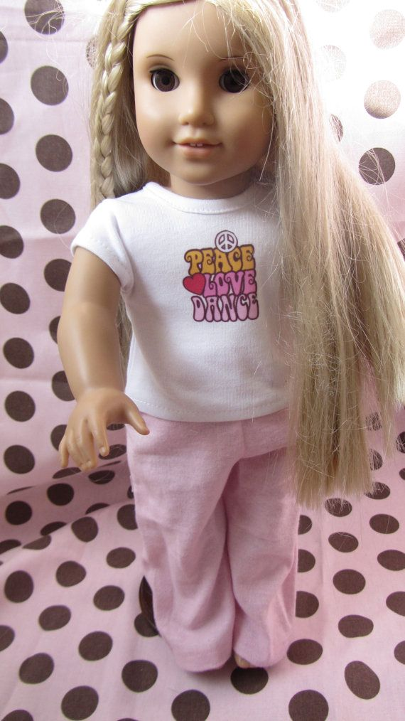 Peace, love and dance t-shirt and pink pajama pants made to fit 18 inch dolls. These are great for the little dancer in your life.
