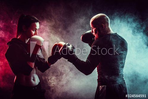 Woman exercising with trainer at boxing and self defense lesson, studio, smoke on background. , #Affiliate, #trainer, #boxing, #Woman, #exercising, #defense #Ad
