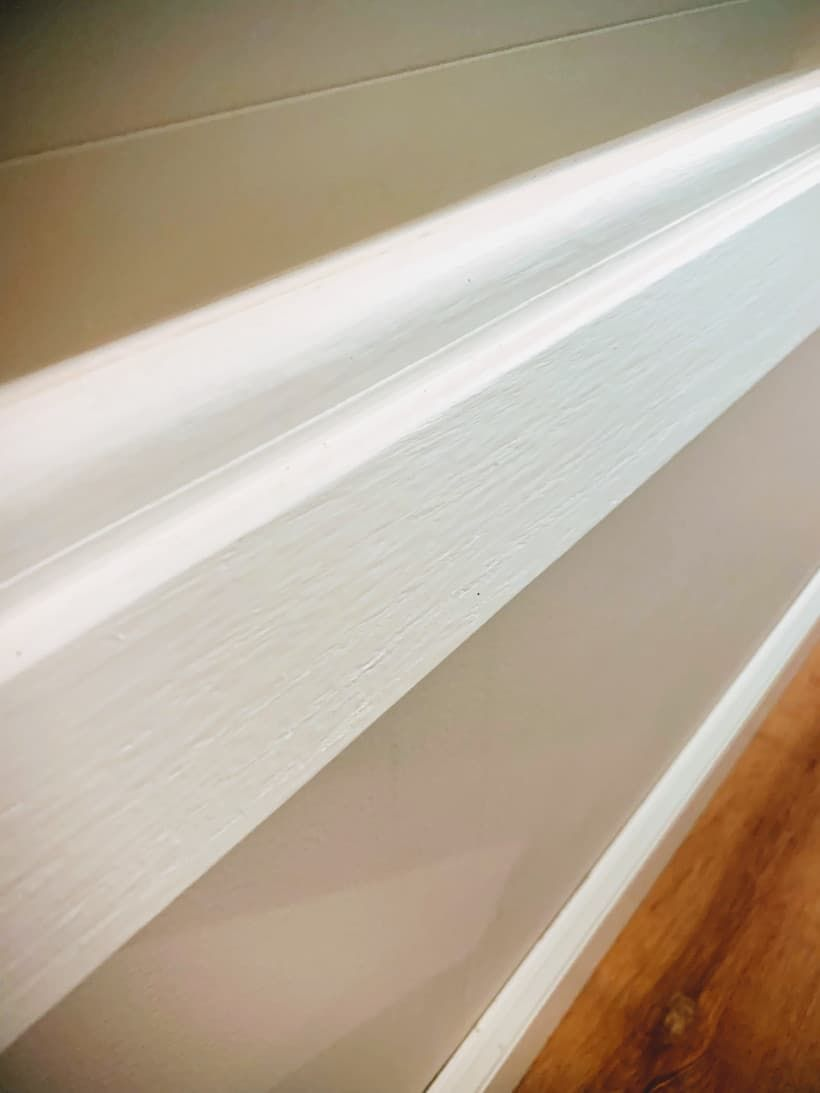 A Beginners Guide On How To Caulk Trim Baseboards A Well Purposed Woman In 2020 Baseboards Painting Trim Painting Trim White