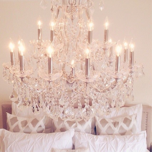 Love this look! Chandelier and Ikat pillows. Beautiful. @Jaclyn Booton Booton Booton Hill