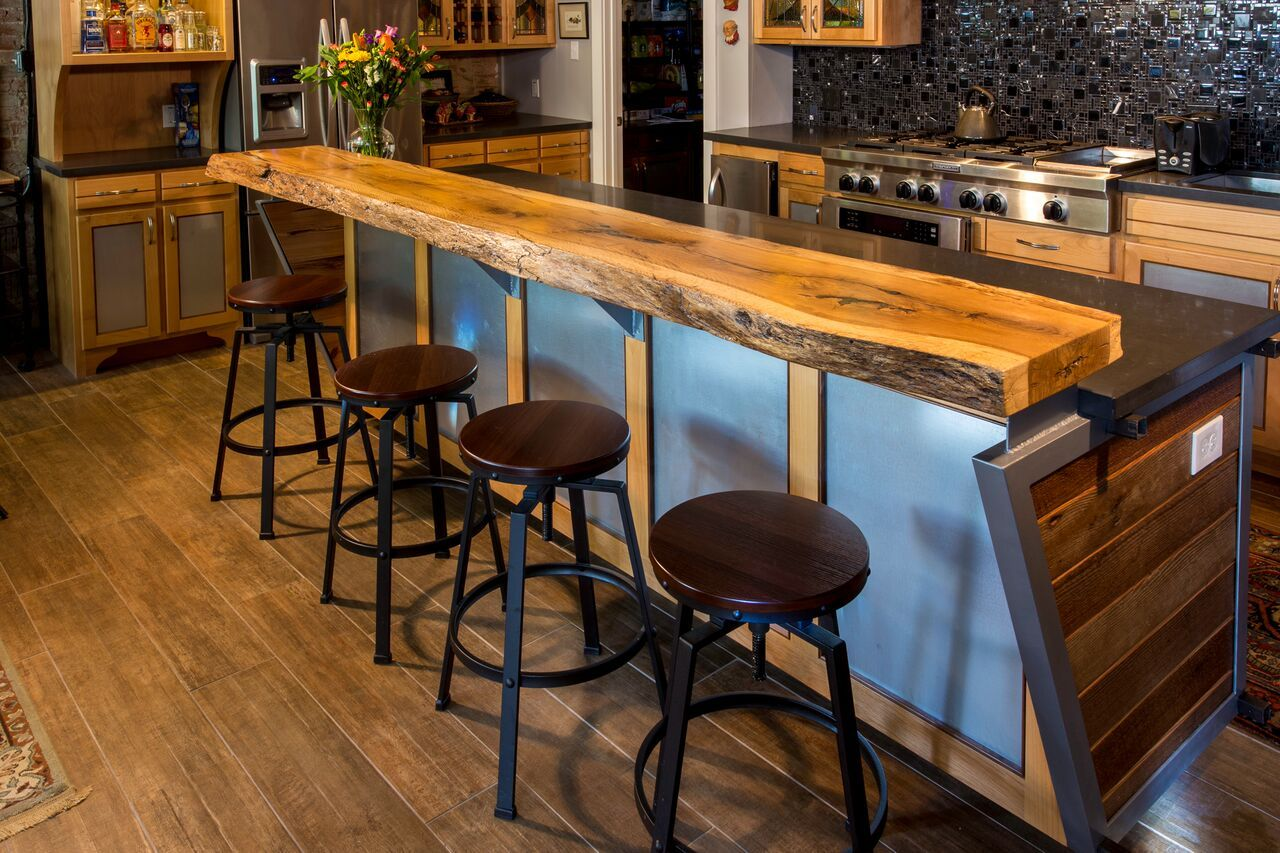 Created for a loft in Waco, Texas, this custom-made bar gives the kitchen a casual luxury. Designed and fabricated by Stanton Studios. #custom #woodworking #bar