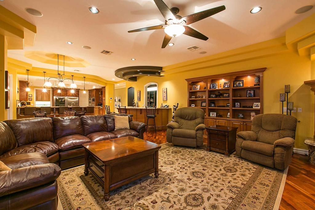 Comprised of 20' tray ceilings, polished stone and hardwood floors, ceiling high windows, notable structural design and warm finishes; the entire home flows from room to room with an inviting ambiance and an eye for detail.