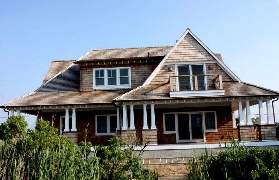 Has a double slope on all four sides of a house; often ...