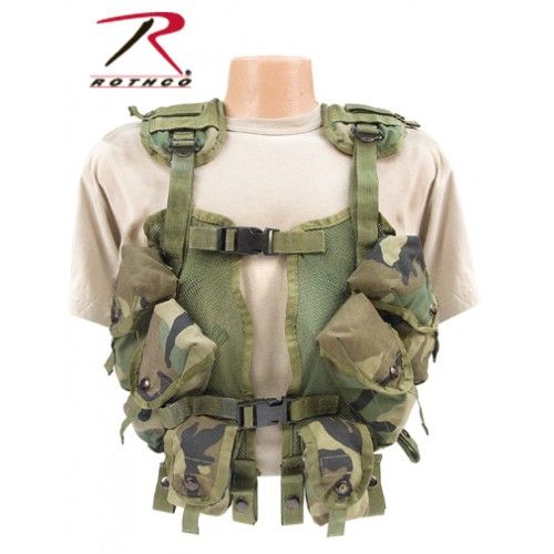 Rothco G.I. Woodland Camo Enhanced Tactical Vest    - U.S. Made  - 100% Nylon  - 4 Mag Pouches  - 2 Utility Pouches  - Snap Loops To Attach To Pistol Belt  - Used, Excellent Condition  - Limited Quantities