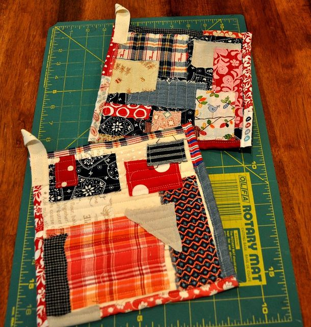 potholders by vickivictoria, via Flickr. My sister would love these! I would back with a couple of layers of old towels.
