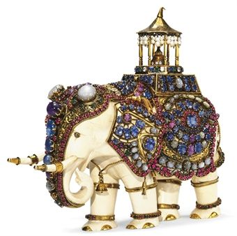 An Indian carved-ivory elephant adorned with gold and jewels, c.1900; the elephant is a symbol of power and prestige in India; the chattra, or golden umbrella, is a symbol of Indian royalty. (Christie's)