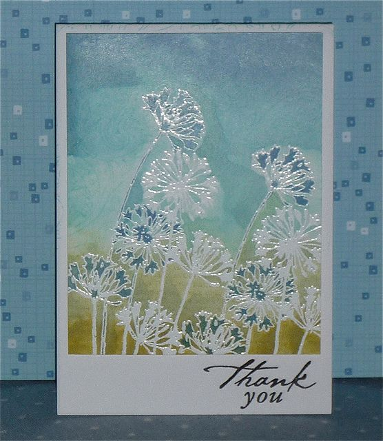 Distress inks on quite glossy paper -  Spritzed with perfect pearls -  And the green background is stamped with HA friend definition, and the blue top part with HA Flower Dot pattern.