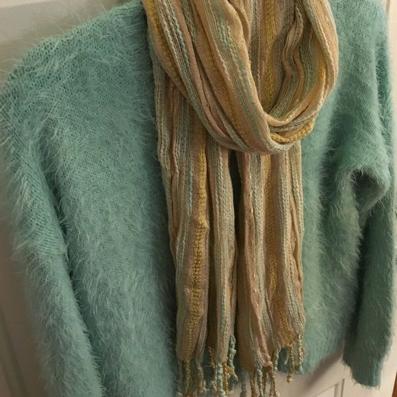 Cute neutral colored scarf with fringed ends Cream, light blue, yellow with a bit of shimmer fringed scarf. Goes with just about anything! Accessories Scarves & Wraps