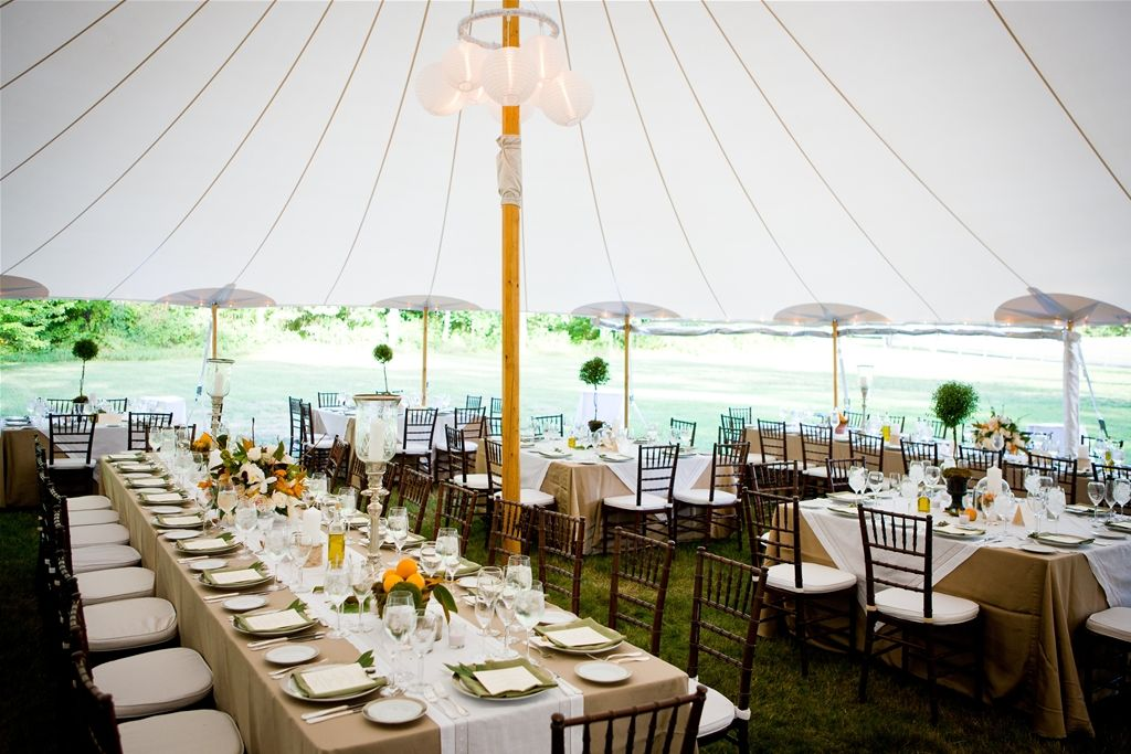 Durkin's Sailcloth Tents have natural wood poles, giving ...