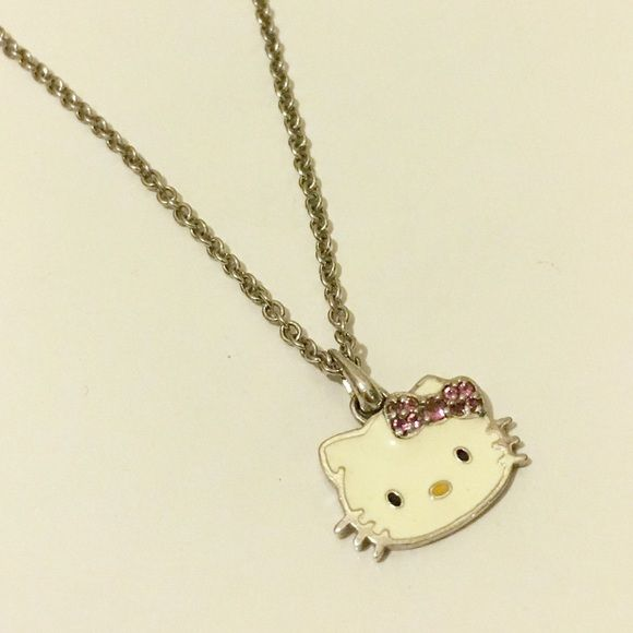 """Hello Kitty Necklace The cutest little Hello Kitty necklace! Sterling silver, enamel, and pink sapphires. 18"""" chain. I received this as a gift years ago and only wore it a few times. Hello Kitty Jewelry Necklaces"""