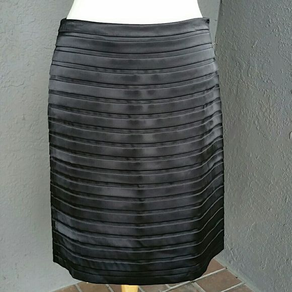 """Black Skirt Tiered Shiny Satin Effect sz. 8 Shiny layers tiered to lay flat so it keeps a pencil skirt fit look! This is a beautiful black skirt for evenings, special events, etc. Like new condition. 15.5"""" dropped waist (note: no waistband, """"blind"""" side zipper) 23"""" from waist top to hem bottom. Fits loosely so it hangs well. Dress Barn Skirts"""
