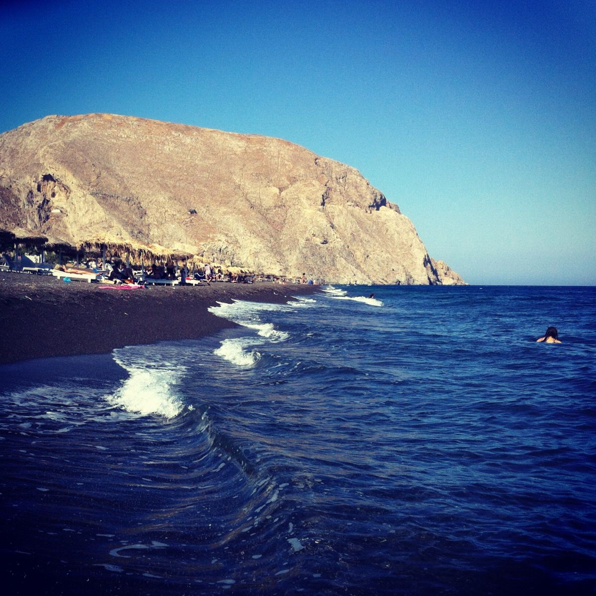 Best Quiet Places To Travel: Perissa Beach, Black Sand, Santorini Greece. My Go To