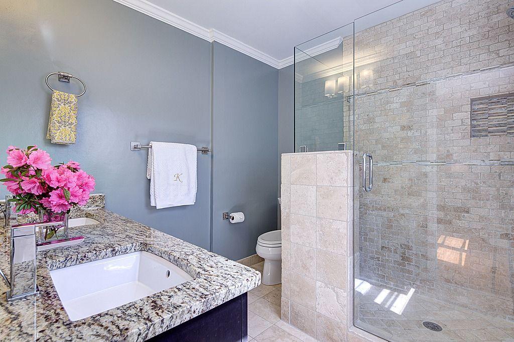 Blue gray neutral bathroom, floor to ceiling tile, cool tones