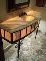 Ornamental iron sink stand is outstanding bathroom decor.  #iron art #bathroom decorating