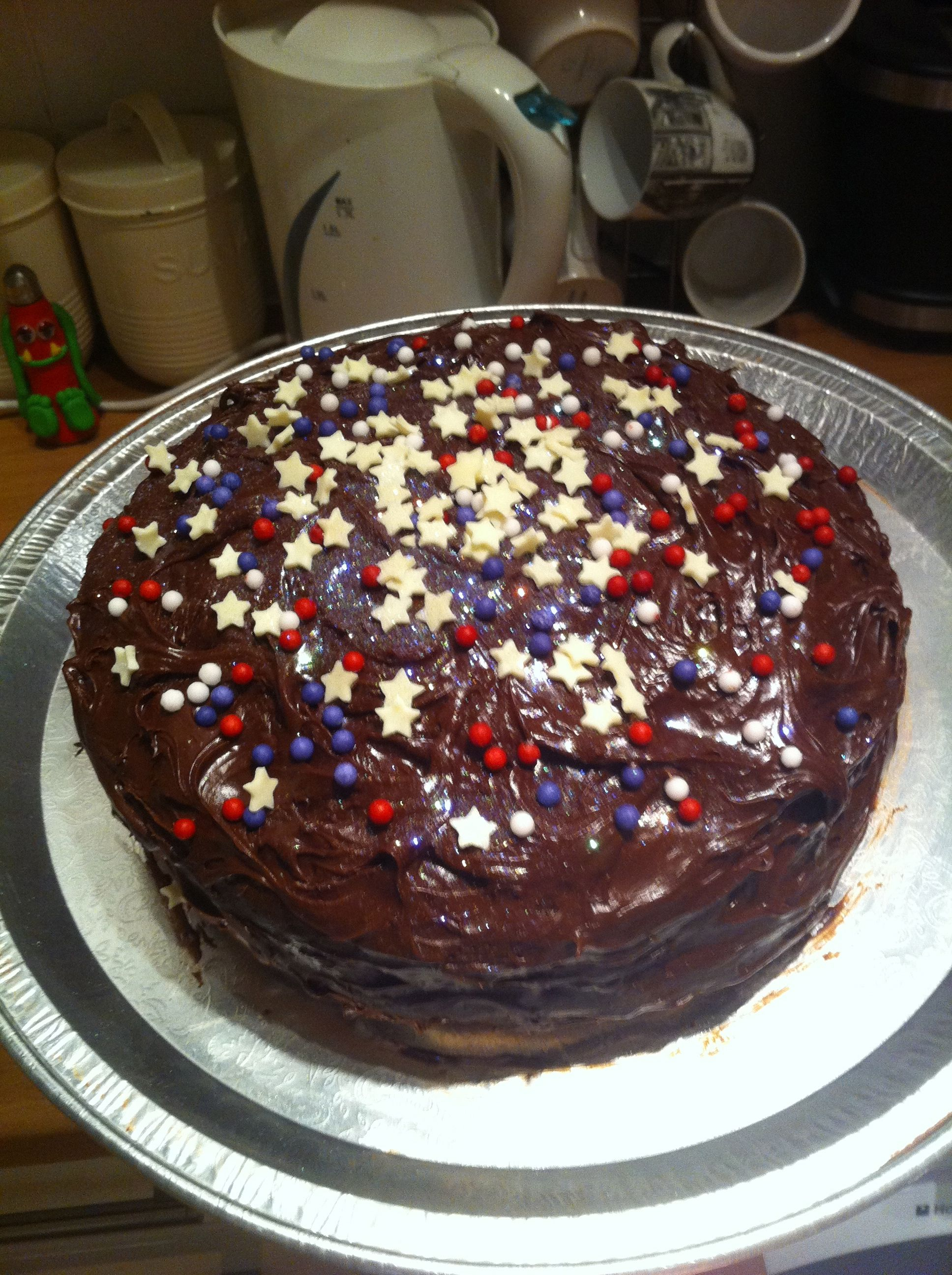 Classic Betty Crocker (cheating!) Devil's Food Cake with Chocolate Fudge Icing, White Chocolate Stars, Blue and Red Sugar Balls and most importantly lots of edible GLITTER!! Gluttony in it's most fabulous