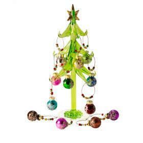 Wine Charms | Wine Accessories A wine charm set that acts as a display piece. A beautiful glass christmas tree with a small mirrorred base and 12 hanging wine charms christmas ornaments. Guests can pick an ornamnet off the tree and place it on their glass to mark their glasses. What a way to start the party!  See more at: http://www.bellavitabags.com/awm-snowflakes.html#sthash.1roSIqFP.dpuf
