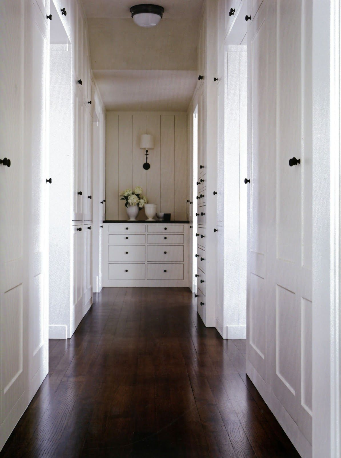vertical V groove at the end of the hall Built ins