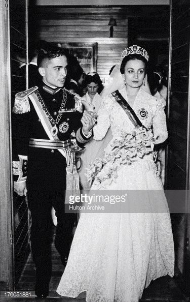 King Hussein of Jordan married Sharifa Dina bint 'Abdu'l-Hamid on April 18, 1955 in Amman, Jordan. Born in Egypt, she was a distant cousin of the king. The bride was 26 and the groom was 19. As is custom in the Muslim religion, the bride was not present at the ceremony, and her father signed the wedding register for her. She joined the king at their reception at Raghadan Palace. Upon her marriage she became Queen of Jordan. It soon became apparent that the king and queen had little in…