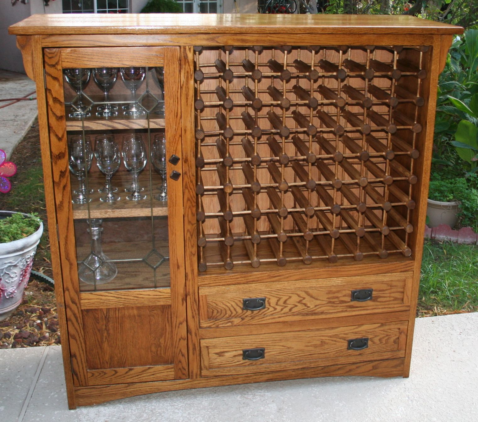 I converted an old TV cabinet into a wine rack. It'll hold 64 ...