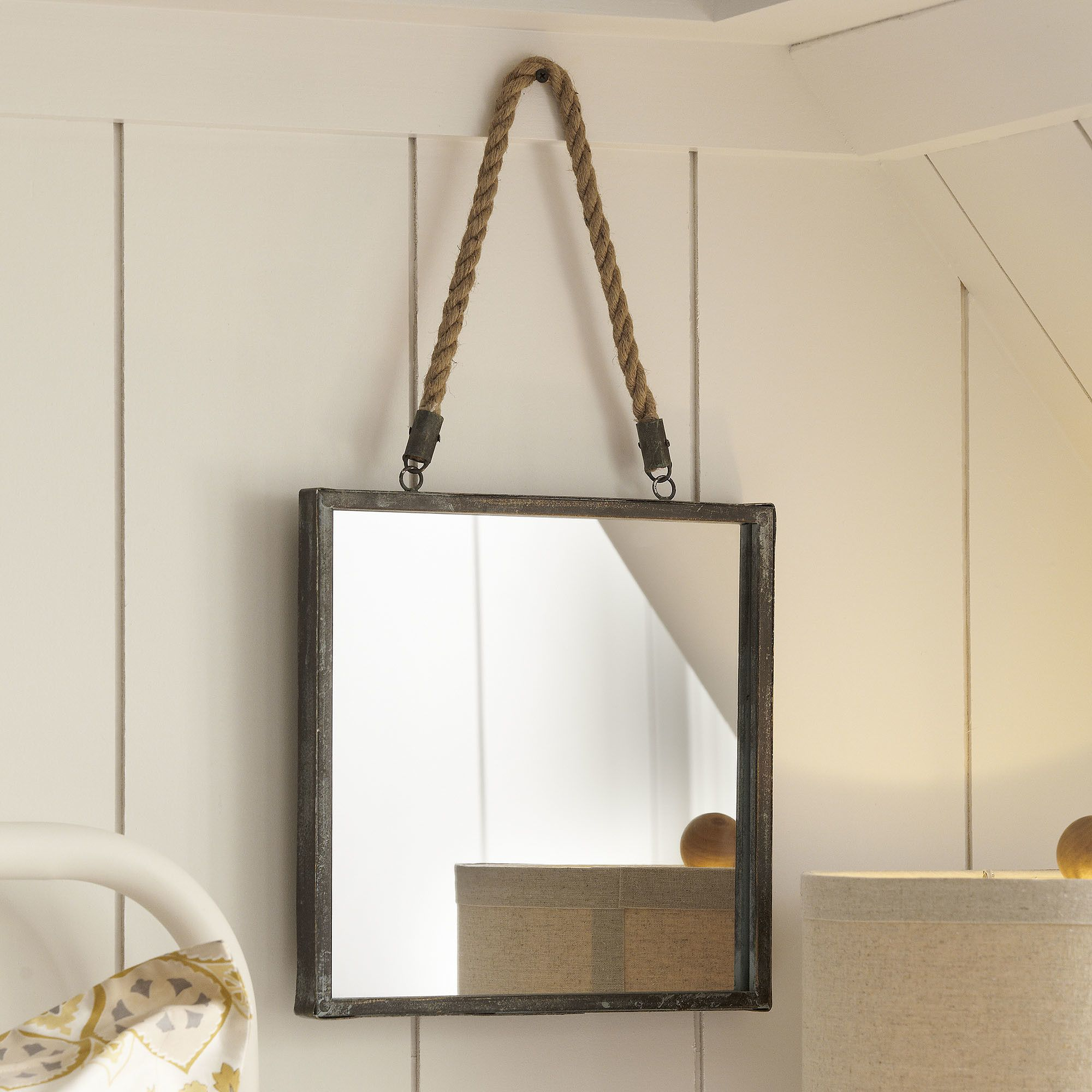 goodhue mirror with its metal frame and rope hanger this nautical mirror adds a