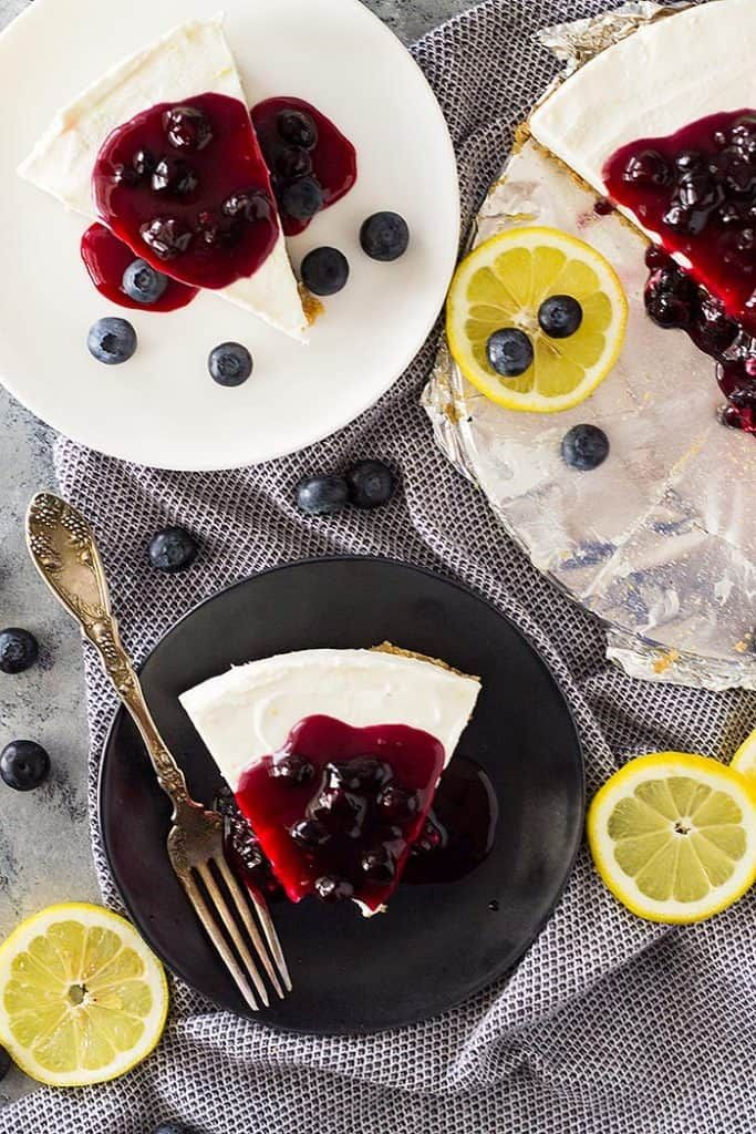 This creamy, light and fluffy No Bake Lemon Blueberry Cheesecake recipe is the perfect springtime dessert! Complete with a homemade no bake buttery crust. #lemonblueberrycheesecake