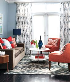 Love this living room palette- want those orange chairs!