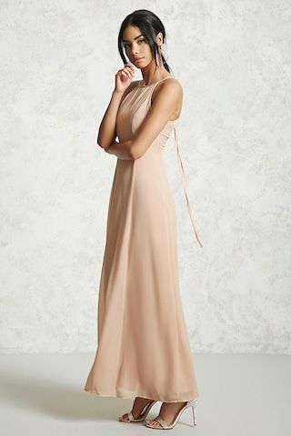 A chiffon woven maxi dress featuring a high neckline, cami straps, princess seams, and a lace-up plunging back.
