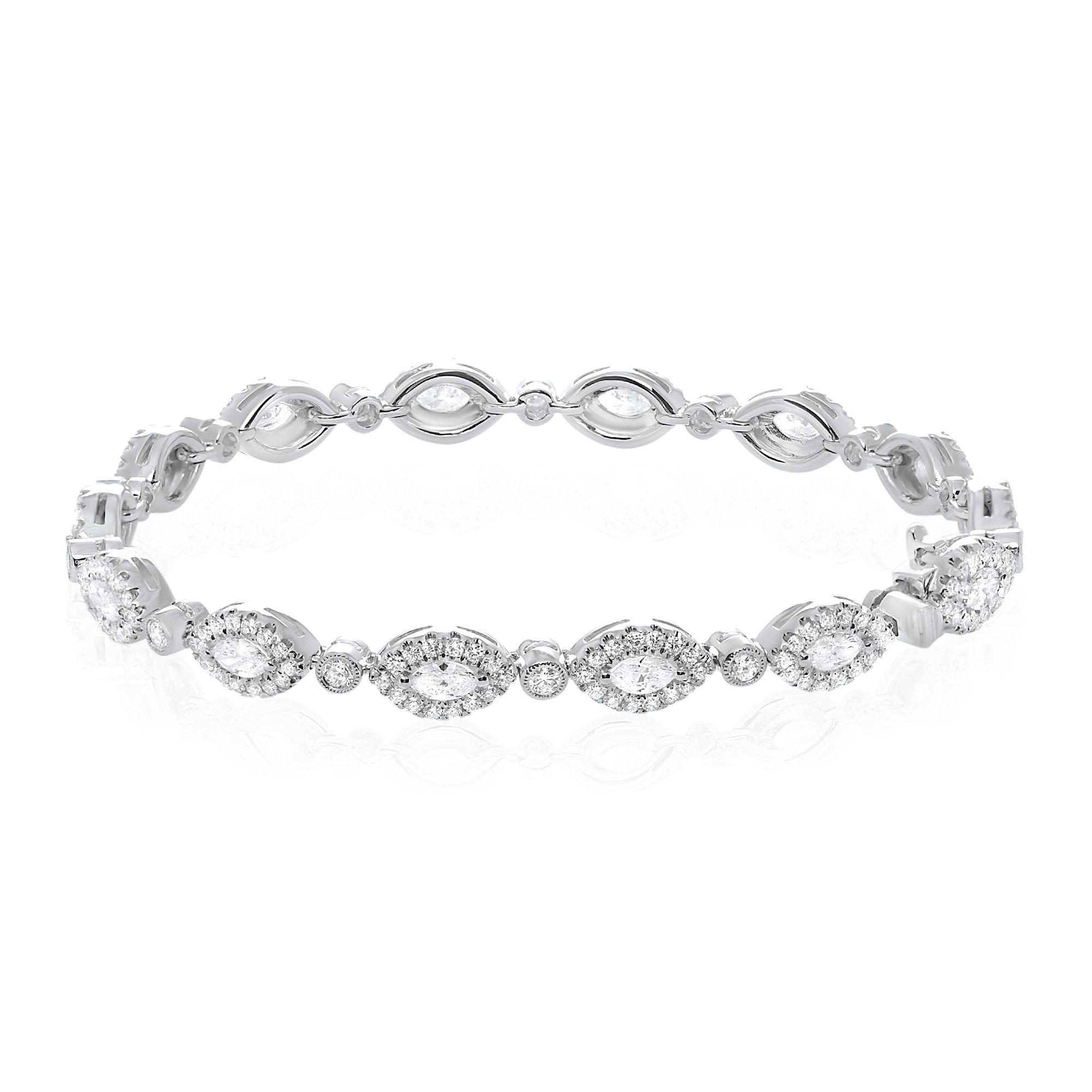 Shop this diamond and white gold halo design marquis diamond