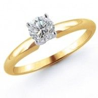 The diamond solitaire ring is a timeless classic and the quintessential reflection of everlasting love. This beautiful engagement ring features a fiery 1/3 carat round cut diamond four-prong set in po...