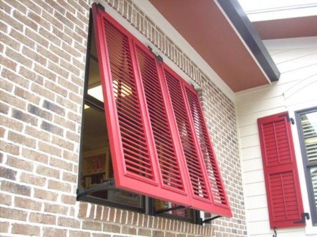 Red bahama shutter exterior shutters pinterest for Brick houses without shutters