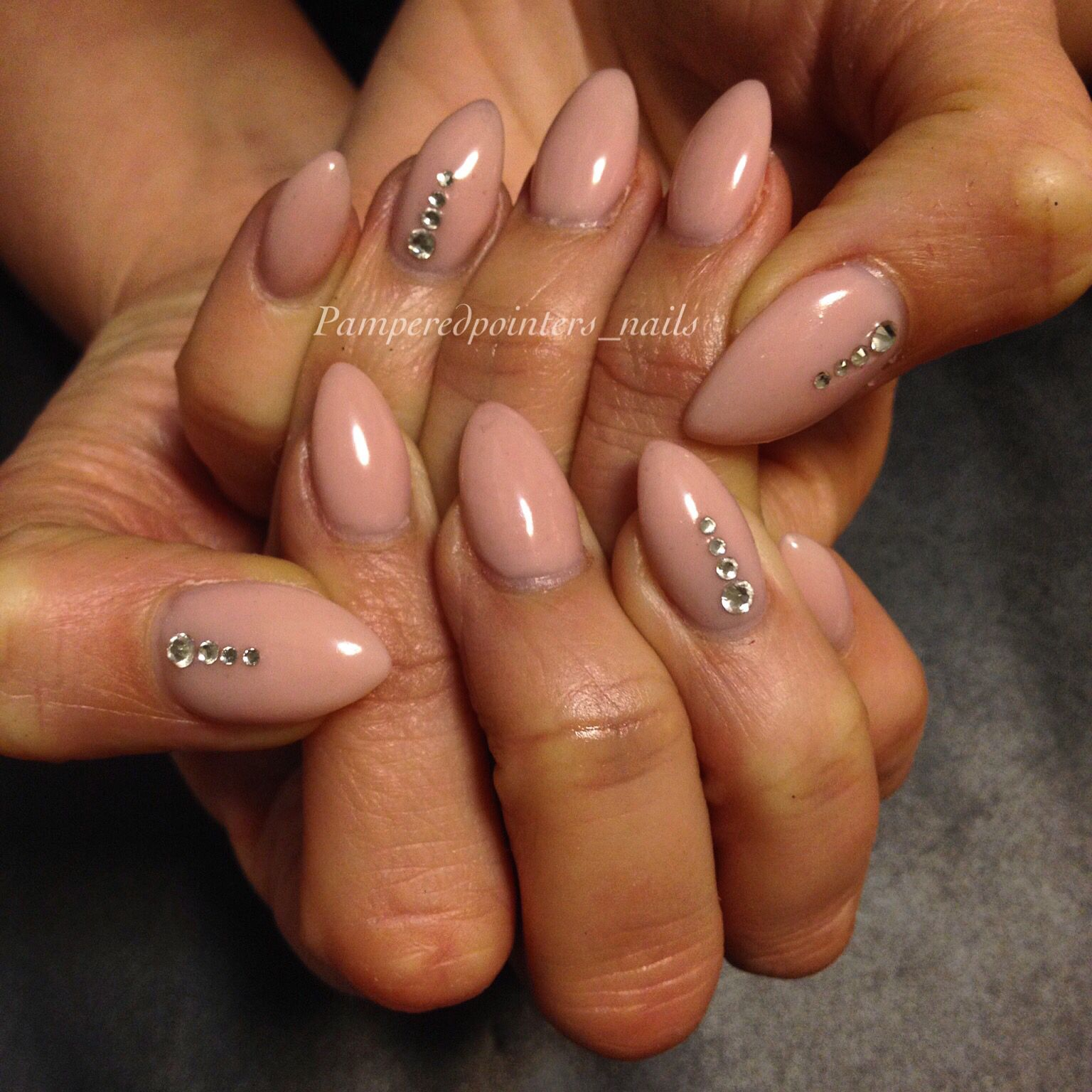 Elegant stilettos with nude gel overlay on natural nails ...