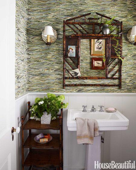 Pheasant wallpaper by Twigs in the powder room recalls Italian marbled paper. Mirror, Reborn Antiques. Kohler sink.