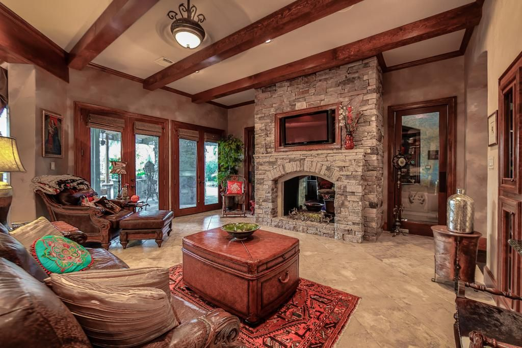 9 Foot Vaulted Ceiling With Wood Beams And Stone Fireplace