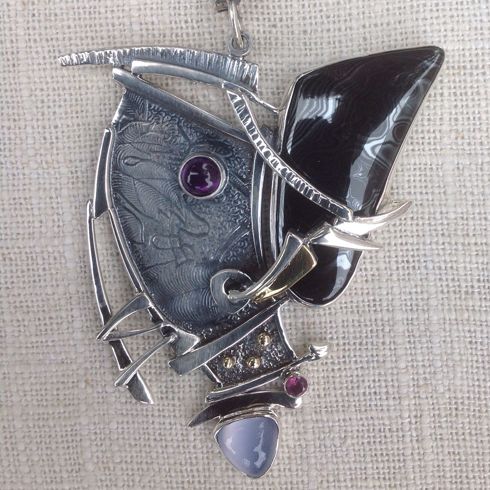 Pendant made out of sterling silver, 18K Gold and various stones.