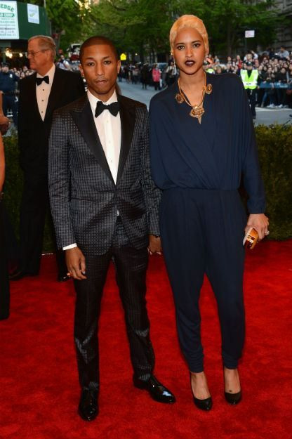 Pharrell Williams (L) and Helen Lasichanh attend the Costume Institute Gala for the 'PUNK: Chaos to Couture' exhibition at the Metropolitan Museum of Art on May 6, 2013 in New York City. (Photo by Larry Busacca/Getty Images)