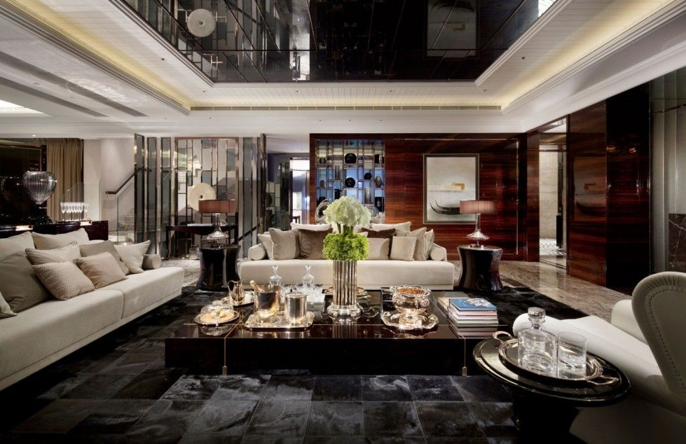 Un soggiorno arredato con divani moderni di lusso | Library,Freedom ...